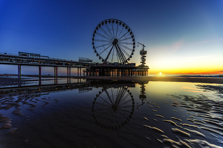Scheveningen pier and beach at the sunset time Stock Photo