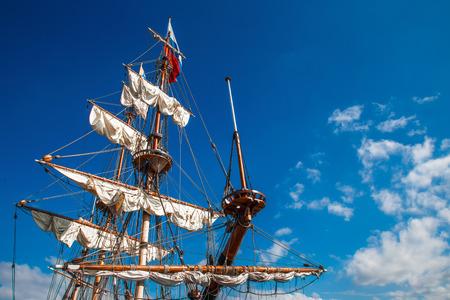 Three masts boat with folded wings Standard-Bild