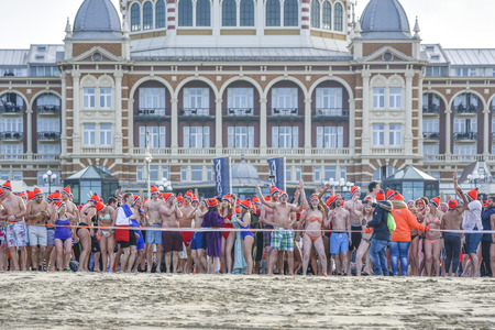 SCHEVENINGEN, 1 January 2018 - Dutch people follow the strong tradition of the first new year dive standing behind the starting line ready to run toward the frozen North Sea water