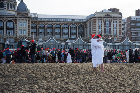SCHEVENINGEN, 1 January 2018 - Couple congrats each other for having accomplished the new year dive in a frozen North Sea water