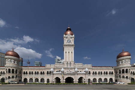 Marble Bungunan Sultan Abdul Samad building in front the Merdeka square (Malaysian independence square) under a beautiful and blue sky, in Kuala Lumpur, Malaysia Stock Photo