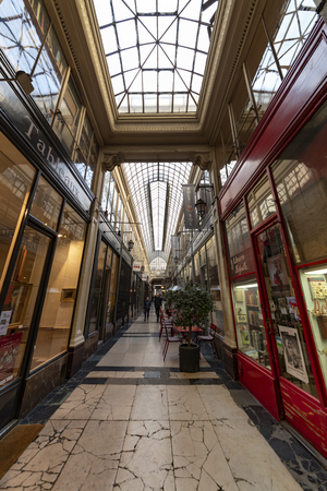PARIS, 27 Octobre 2018 - Inside de Passage des Panamas old roof covered passageway in Paris where old books shop, restaurants and souvenir shop are still operate
