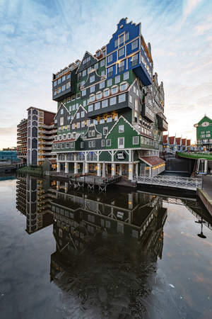 ZAANDAM, 20 January 2019 - Sunset on building made of all type of Dutch architectural style topped up on each others making this building unique in its gender, Zaandam city, Netherlands Sajtókép