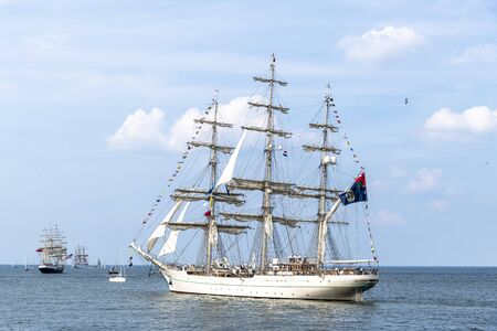 Antique tall ship, vessel leaving the harbor of The Hague, Scheveningen under a sunny and blue sky Stock fotó