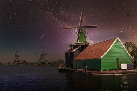 Milkyway on the Dutch green sawmill at the edge of river facing the wind and resting before servicing again next day Foto de archivo