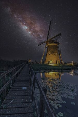 Milky way on the windmill servicing its duty under a warm cloudless and warm weather at Kinderdijk, Netherlands
