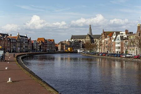 Canal view on the Haarlem and Bavo church at the center city skyline along the canal, Netherlands
