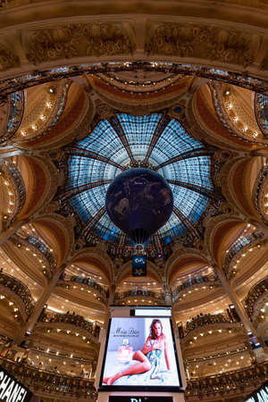 PARIS, 10 October 2017 - Up view of Galerie Lafayette shopping mall with its blue tainted glass roof and ceiling