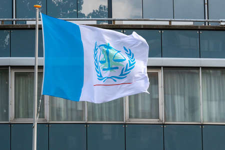 LEIDSCHENDAM, 18 August 2020 - Flag of the Special Tribunal for Lebanon (STL) floating and flying under the winds in from the building at the rendering day of Rafic Hariri killing judgement.