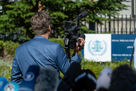 LEIDSCHENDAM, 18 August 2020 - Cameraman scouting and waiting in front the Special Tribunal for Lebanon, for the exit of Rafic Hariri, Lebanon ex-Prime Minister after the decision of the tribunal