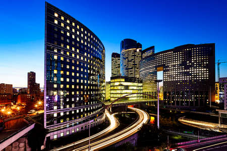 PARIS, 26 October 2015 - Night view of the Paris La Défense business district and headquarters of  corporation and multinational firm illuminated at the blue hours