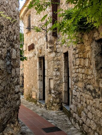 Beautiful architecture of the village houses; narrow streets of the old town of Eze on Cote dAzur 스톡 콘텐츠
