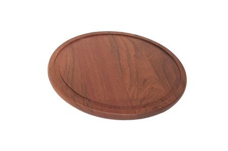 Round brown cutting board isolated on a white background photo