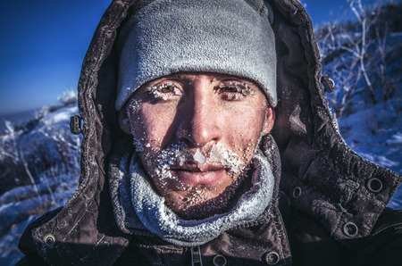 face covered: The mans face covered with ice