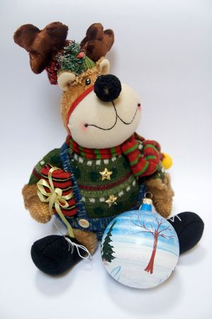 Christmas Reindeer with manually painted ornament over white photo