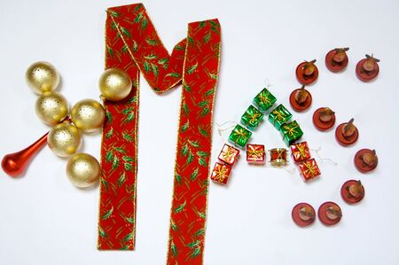 Christmas Ornament, XMas in gold, red and green over white photo