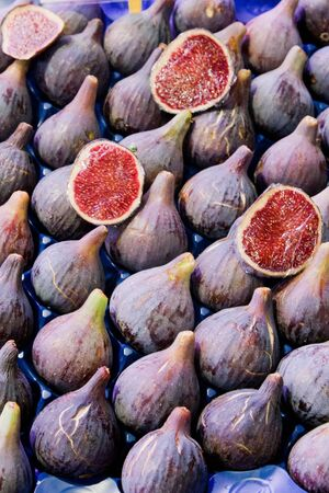 Fresh red figs ready for sale, full and halved photo