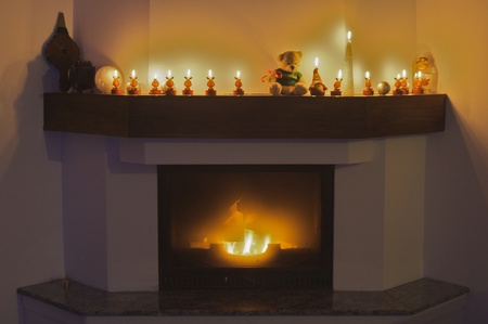 Interior image with fireplace, decorations and reindeer candles for Christmas feeling photo