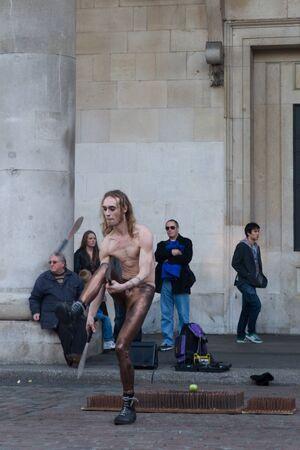 covent garden market: A street performer in front of Covent Garden market, London, UK, Sunday, November 13, 2011.