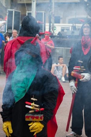 BARCELONA - AUGUST 21: Fire devils in the fire-run (Correfoc) as part of the Gracia Festival 2011 (La Festa Major de Gracia 2011) on August 21/22, 2011 in Vila de Gracia, Barcelona, Spain Stock Photo - 11828281