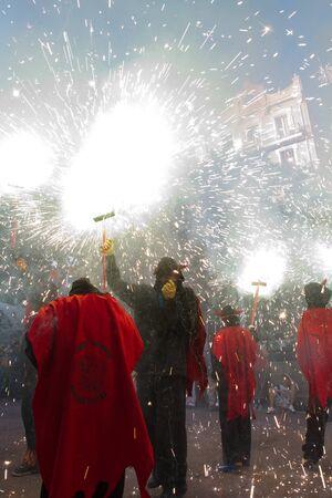 BARCELONA - AUGUST 21: Fire devils in the fire-run (Correfoc) as part of the Gracia Festival 2011 (La Festa Major de Gracia 2011) on August 21/22, 2011 in Vila de Gracia, Barcelona, Spain Stock Photo - 11828234