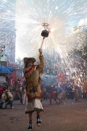 BARCELONA - AUGUST 21: Fire devils in the fire-run (Correfoc) as part of the Gracia Festival 2011 (La Festa Major de Gracia 2011) on August 21/22, 2011 in Vila de Gracia, Barcelona, Spain Stock Photo - 11828302