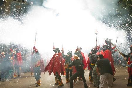 BARCELONA - AUGUST 21: Fire devils in the fire-run (Correfoc) as part of the Gracia Festival 2011 (La Festa Major de Gracia 2011) on August 21/22, 2011 in Vila de Gracia, Barcelona, Spain Stock Photo - 11828272
