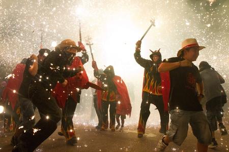 BARCELONA - AUGUST 21: Fire devils in the fire-run (Correfoc) as part of the Gracia Festival 2011 (La Festa Major de Gracia 2011) on August 21/22, 2011 in Vila de Gracia, Barcelona, Spain Stock Photo - 11828359