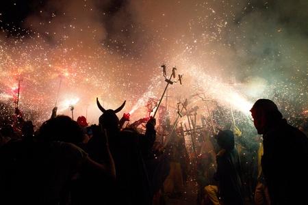 BARCELONA - AUGUST 21: Fire devils in the fire-run (Correfoc) as part of the Gracia Festival 2011 (La Festa Major de Gracia 2011) on August 21/22, 2011 in Vila de Gracia, Barcelona, Spain Stock Photo - 11828460