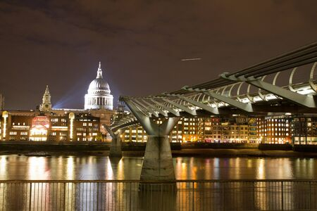 Night view of St Paul's Cathedral and Millenium Bridge in London, UK on 23 November 2011