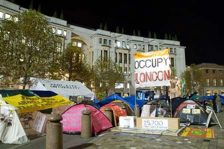 occupy london: LONDON - NOVEMBER 23: Night view of Occupy London protest, in front of St Pauls Cathedral on November 23, 2011 in London, UK Editorial