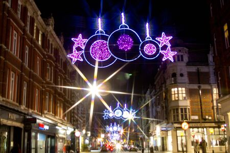 Christmas street lights and traffic by night on Marylebone Street, London, UK on 06 December 2011 Stock Photo - 11828205