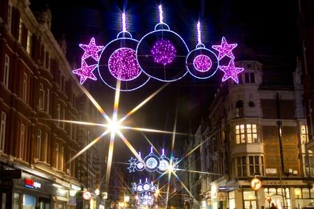 christmas street lights and traffic by night on marylebone street london stock photo 11827757