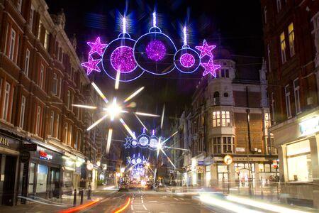 Christmas street lights and traffic by night on Marylebone Street, London, UK on 06 December 2011 Stock Photo - 11828249