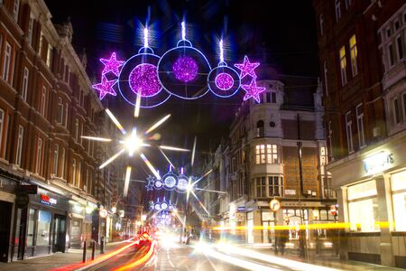 Christmas street lights and traffic by night on Marylebone Street, London, UK on 06 December 2011 Stock Photo - 11828264