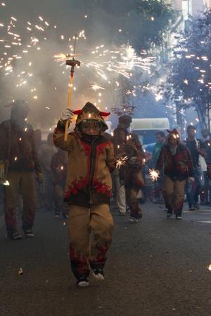 BARCELONA - AUGUST 21: Fire devils in the fire-run (Correfoc) as part of the Gracia Festival 2011 (La Festa Major de Gracia 2011) on August 21/22, 2011 in Vila de Gracia, Barcelona, Spain Stock Photo - 11828861