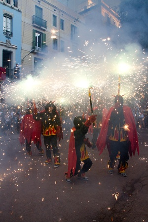 BARCELONA - AUGUST 21: Fire devils in the fire-run (Correfoc) as part of the Gracia Festival 2011 (La Festa Major de Gracia 2011) on August 21/22, 2011 in Vila de Gracia, Barcelona, Spain Stock Photo - 11828964