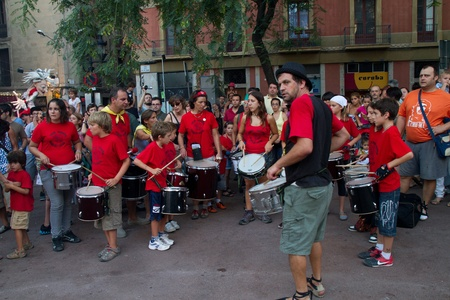 patron of europe: BARCELONA - AUGUST 21: Traditional drums band (gralla) in the Gracia Festival 2011 (La Festa Major de Gracia 2011) on August 21, 2011 in Vila de Gracia, Barcelona, Spain