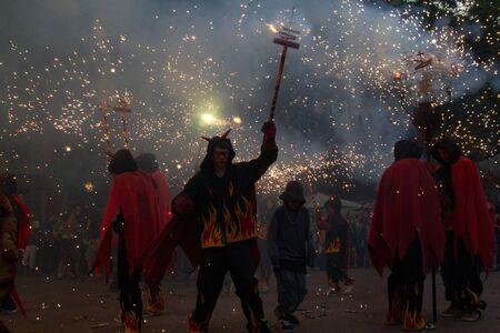 fireruns: BARCELONA - AUGUST 21: Fire devils in the fire-run (Correfoc) as part of the Gracia Festival 2011 (La Festa Major de Gracia 2011) on August 2122, 2011 in Vila de Gracia, Barcelona, Spain