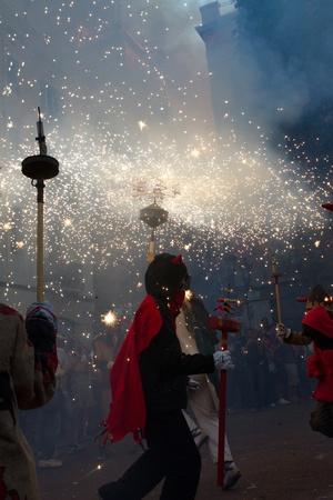 patron of europe: BARCELONA - AUGUST 21: Fire devils in the fire-run (Correfoc) as part of the Gracia Festival 2011 (La Festa Major de Gracia 2011) on August 2122, 2011 in Vila de Gracia, Barcelona, Spain