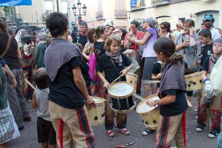 fireruns: BARCELONA - AUGUST 21: Traditional drums band (gralla) in the Gracia Festival 2011 (La Festa Major de Gracia 2011) on August 21, 2011 in Vila de Gracia, Barcelona, Spain
