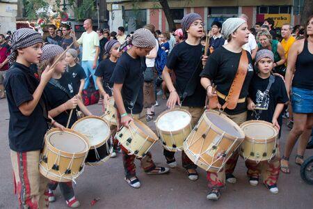 patron of europe: BARCELONA - AUGUST 21: Members of the traditional drums band (gralla) in the Gracia Festival 2011 (La Festa Major de Gracia 2011) on August 21, 2011 in Vila de Gracia, Barcelona, Spain. Unidentified children