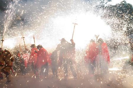BARCELONA - AUGUST 21: Fire devils in the fire-run (Correfoc) as part of the Gracia Festival 2011 (La Festa Major de Gracia 2011) on August 21/22, 2011 in Vila de Gracia, Barcelona, Spain Stock Photo - 11828730