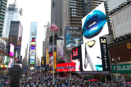 NEW YORK - SEPTEMBER 4: People, broadway shows ads and TV ad bilboards in Times Square, New York on September 04, 2011 in New York City, New York, USA
