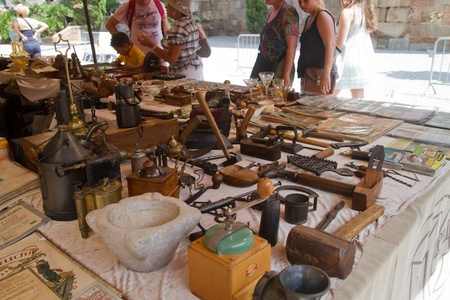 BARCELONA - JULY 30: Flea market in front of the Cathedral in Barrio Gotico on July 30, 2011 in Barcelona, Spain