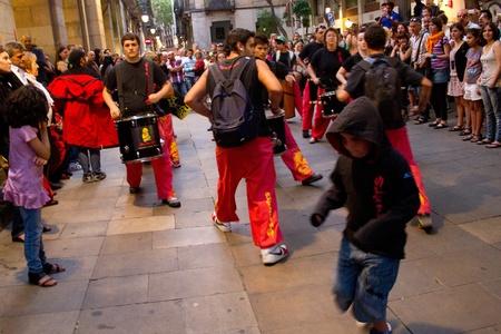 merce: BARCELONA - JULY 17: Drum bands  in Festa Major del Raval Festival on July 17, 2011 in Raval, Barcelona, Spain