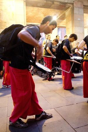 merce: BARCELONA - JULY 17: Drum players at Festa Major del Raval Festival on July 17, 2011 in Plaça del Bonsucces, Raval, Barcelona, Spain Editorial