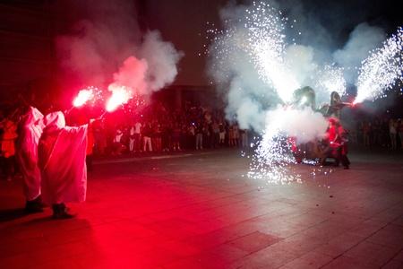 BARCELONA - JULY 17: Fire dragon and fire devils (carrefoc y diablos) in Festa Major del Raval Festival on July 17, 2011 in Raval, Barcelona, Spain