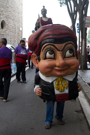 BARCELONA - JULY 17: Street bands, giants and big heads (Gigantes y Cabezudos) in Festa Major del Raval Festival on July 17, 2011 in Raval, Barcelona, Spain Stock Photo - 11925554