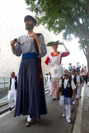 patron of europe: BARCELONA - JULY 17: Giants and big heads (Gigantes y Cabezudos) in Festa Major del Raval Festival on July 17, 2011 in Raval, Barcelona, Spain